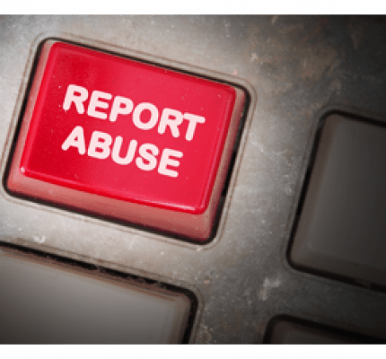 "Keyboard featuring a ""Report Abuse"" button in red"