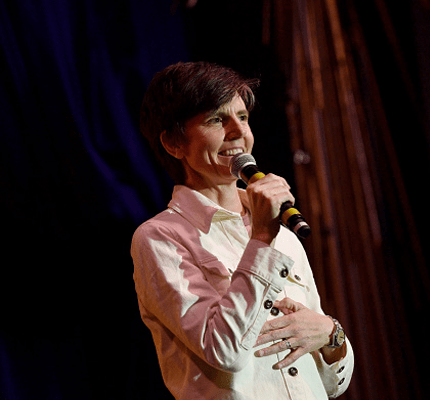 Tig Notaro on stage holding microphone