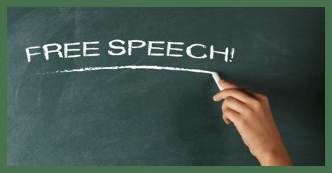 Free speech written on green chalkboard