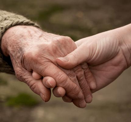 Older couple holding hands