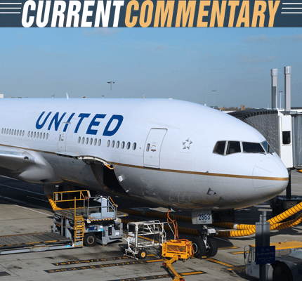 United Airlines plane at an airport gate