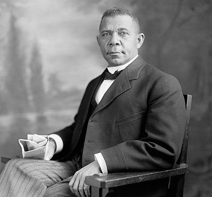 Booker T Washington sitting in a chair