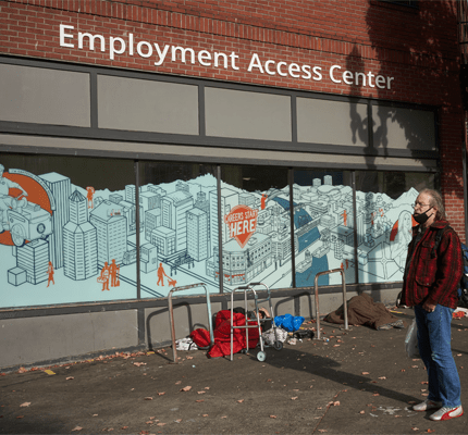 Man in front of building that says Employment Access Center